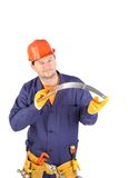 Worker in hard hat holding saw Royalty Free Stock Photos