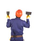 Worker in hard hat holding spatula. Stock Photography