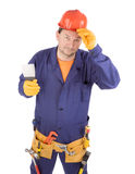 Worker in hard hat holding spatula. Royalty Free Stock Image