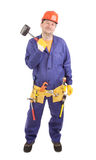 Worker in hard hat holds hammer. Stock Photos