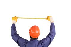Worker in hard hat measure with ruler Stock Images