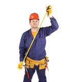 Worker in hard hat measure with ruler. Royalty Free Stock Image
