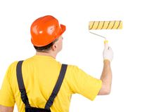 Worker in hard hat working with roller Royalty Free Stock Photography