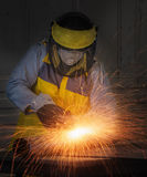 Worker hard work Electric wheel grinding on steel structure Stock Photography