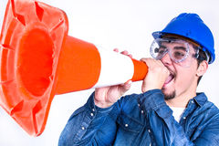 Worker with hardhat and cone Royalty Free Stock Photos