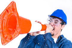 Worker with hardhat and cone Stock Image