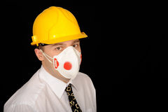 Worker with hardhat and mask. Worker wearing yellow safety hardhat and dust mask Royalty Free Stock Photography