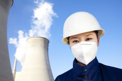 Worker with hardhat and mask at power plant Stock Images