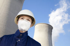Worker with hardhat and mask at power plant Royalty Free Stock Photos