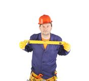 Worker in hardhat with measure ruler. Royalty Free Stock Photos