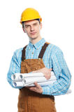 Worker in hardhat and overall with drafts Stock Photos