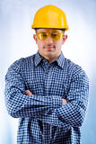 Worker in a hardhat and yellow goggles Royalty Free Stock Image