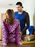 Worker having flirt with young woman Royalty Free Stock Photo