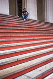 Worker having lunch on steps of Federal Hall Building Stock Photos