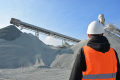 Worker and heavy machine for gravel production Stock Photos