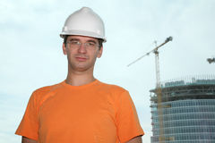 Worker in the helmet. On the building royalty free stock photography