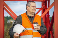 Worker with helmet and coffee at outdoor Royalty Free Stock Photography
