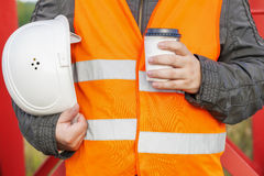 Worker with helmet and coffee Royalty Free Stock Photography