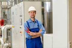 Worker with helmet ,ear protector and goggles royalty free stock photography