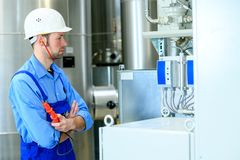 Two worker with helmet ,ear protector and goggles stock photos
