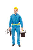 Worker with helmet holding a drill and a tool box Royalty Free Stock Image