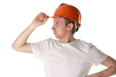 Worker in helmet looks into the distance Stock Image