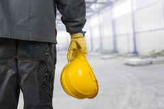 Worker with helmet in production hall Royalty Free Stock Image