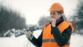 Worker in a helmet smokes stock footage