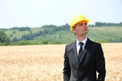 Worker with helmet standing Royalty Free Stock Photography