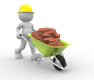 Worker with helmet and wheelbarrow Royalty Free Stock Photo