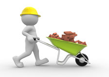 Worker with helmet and wheelbarrow Royalty Free Stock Photos