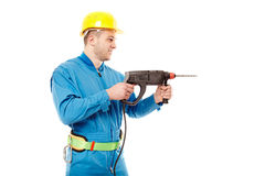 Worker with helmet working with a drill Stock Photos