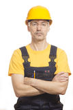 Worker in a helmet and a yellow T-shirt Stock Photography