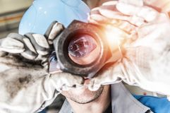 Worker with Hexagon Nut Stock Photography