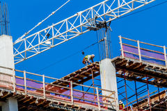 Worker on a High-Rise Construction Job.  Danger. Stock Image