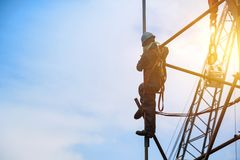 Worker on high at scaffolding with sunset royalty free stock photos