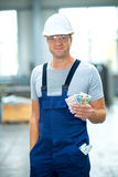 Worker with his wages Stock Image