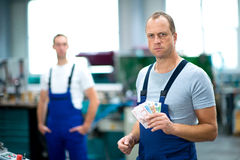 Worker with his wages Royalty Free Stock Photo