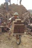 Worker with his wheelbarrow loaded with bricks stock photo