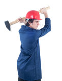 Worker hitting with heavy mallet Stock Images
