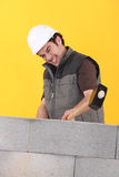 Worker hitting a wall Royalty Free Stock Photo