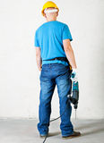 Worker hold electric drill Stock Image