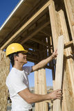 Worker Holding A Beam Royalty Free Stock Photos
