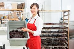 Worker Holding Beef Jerky And Basket At Butcher's Stock Photos