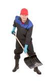Worker holding black shovel. Royalty Free Stock Image