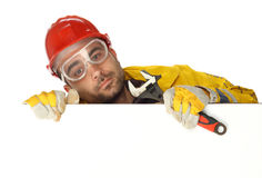 Worker holding blank poster Royalty Free Stock Photo