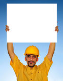 Worker holding blank sign Royalty Free Stock Images