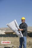 Worker Holding Blueprints Stock Photography