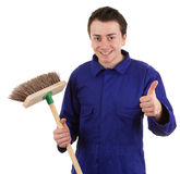 A worker holding a broom Royalty Free Stock Images