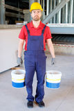 Worker holding buckets Royalty Free Stock Images